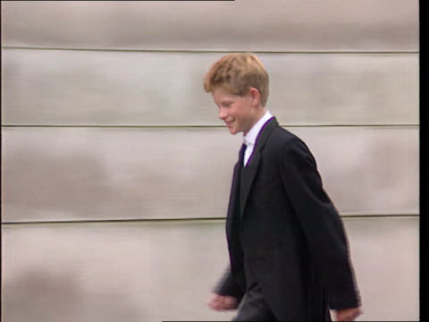 press coverage of royals lib berkshire eton prince harry along as press shouts heard sot - eton berkshire stock videos and b-roll footage