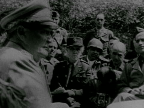 press people war correspondents seated in chairs outside vs surrendered german nazi reichmarshall hermann goering sitting talking w/ unidentified us... - hermann goering stock videos & royalty-free footage