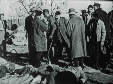 vídeos de stock, filmes e b-roll de press reporters and photographers gather near abandoned well in joplin, missouri, to view bodies of carl mosser, his wife, and their three children,... - 1951