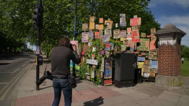 press s photographers takes images of signs in support of the nhs are seen in east london due to the coronavirus covid-19 pandemic. the british... - photography stock videos & royalty-free footage