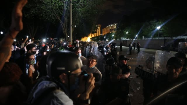 press takes photos of police behind protective shields being confronted by demonstrators holding a protest in response to the police killing of... - protestor stock videos & royalty-free footage