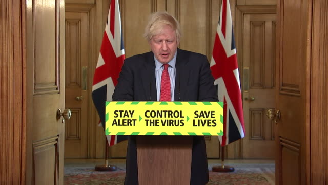 presser boris johnson pm about easing coronavirus lockdown restrictions further and allowing groups of up to 6 people from different households to... - politics and government stock videos & royalty-free footage