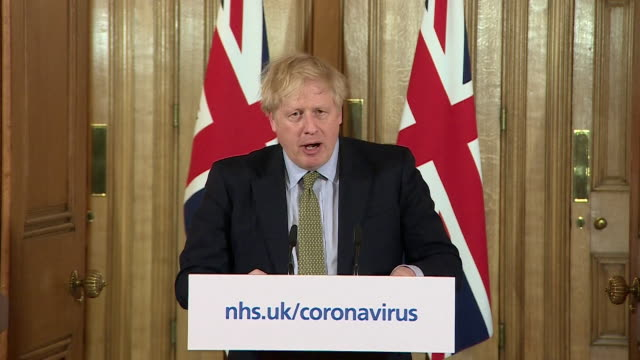 presser boris johnson pm about helping families after he announced schools were to close due to the coronavirus pandemic - inquadratura fissa video stock e b–roll