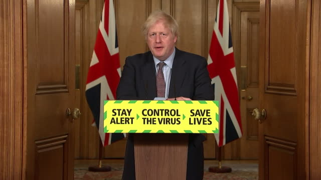 presser boris johnson pm about holidays abroad during coronavirus pandemic everybody should avoid non essential travel we've got to knock this virus... - public celebratory event stock videos & royalty-free footage