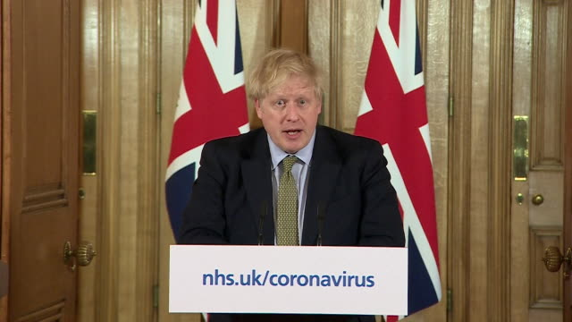 presser boris johnson pm announces that schools will shut for the foreseeable future due to the coronavirus pandemic - inquadratura fissa video stock e b–roll