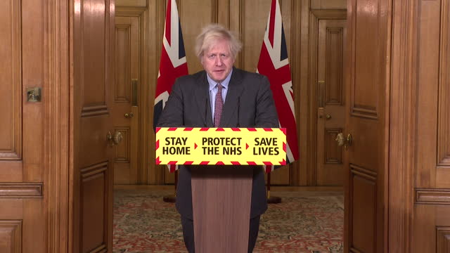 """presser boris johnson pm, announces the uk has now surpassed 100,000 coronavirus deaths """"it is hard to compute the sorrow contained in that grim... - coronavirus stock videos & royalty-free footage"""