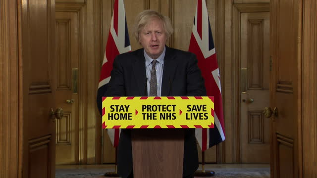 presser boris johnson pm, renews promise to meet target to offer the first dose of the covid-19 vaccine to every adult by the end of july - bonding stock videos & royalty-free footage