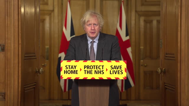 presser boris johnson pm, setting out coronavirus lockdown exit roadmap, how we can't eradicate covid-19 but the vaccines give protection - protection stock videos & royalty-free footage
