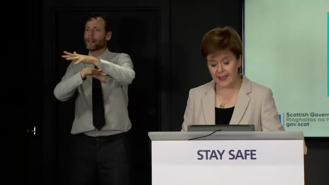 """presser nicola sturgeon msp first minister of scotland about face masks being made mandatory to wear in scotland in shops due to coronavirus pandemic - """"bbc news"""" stock videos & royalty-free footage"""