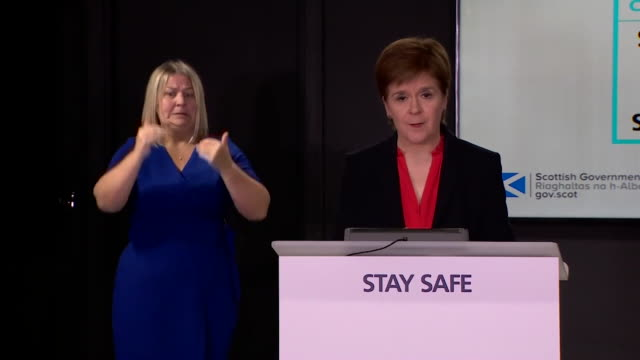presser nicola sturgeon msp first minister of scotland about falling coronavirus figures in scotland we through our efforts are earning our way to... - moving down stock videos & royalty-free footage