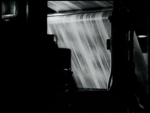presses rapidly rolling two men standing by teletype machines. teletype 'flash verdict reached guilty and life...' - 1935 stock videos & royalty-free footage