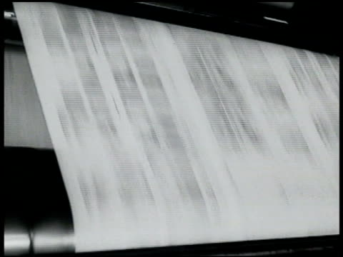 presses rolling horn on wall presses slowing down stopping. 'bruno guilty must die' headlines. - anno 1935 video stock e b–roll