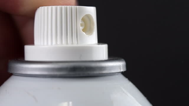 pressing a spray bottle and pressured liquid getting out - 虫除け点の映像素材/bロール