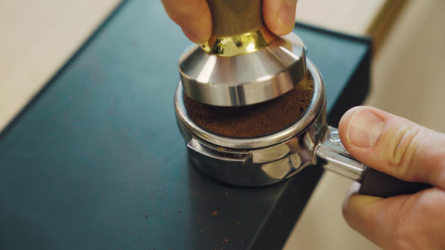 pressing espresso with tamper - seattle coffee stock videos and b-roll footage