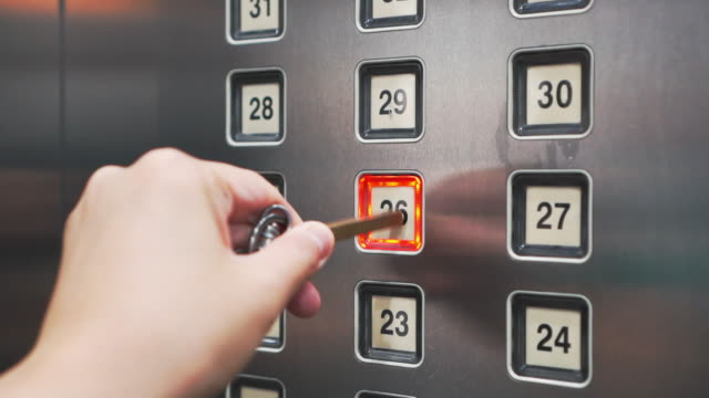 pressing on elevator button for infection prevention - button stock videos & royalty-free footage