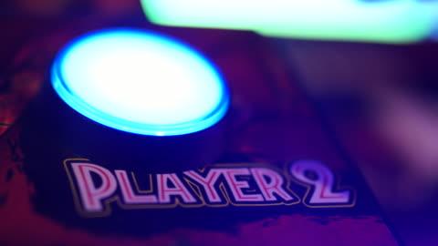 pressing 'start' button on arcade video game machine - gambling stock videos & royalty-free footage