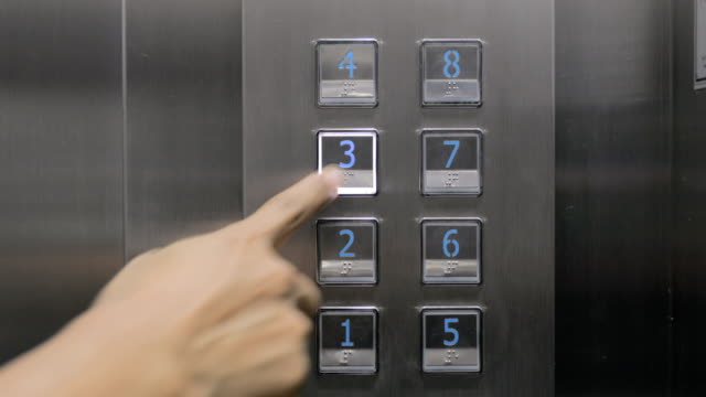 pressing the elevator button, floor number - button stock videos & royalty-free footage
