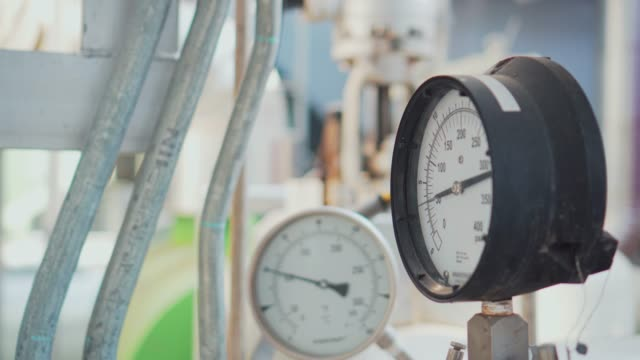 pressure gauge and steel pipeline at industrial plant - boiler stock videos & royalty-free footage