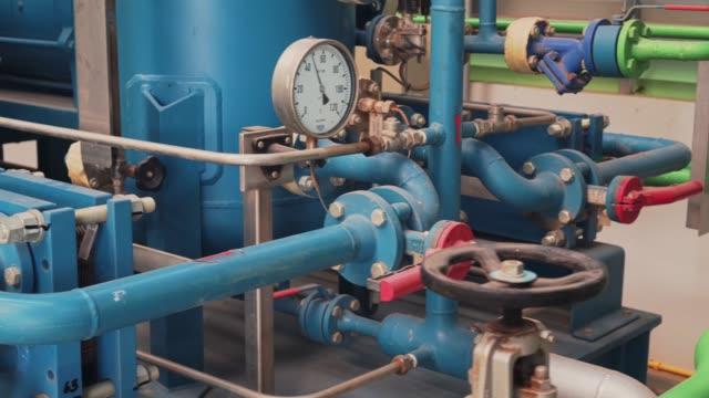 Pressure gauge and Steel pipeline at industrial plant