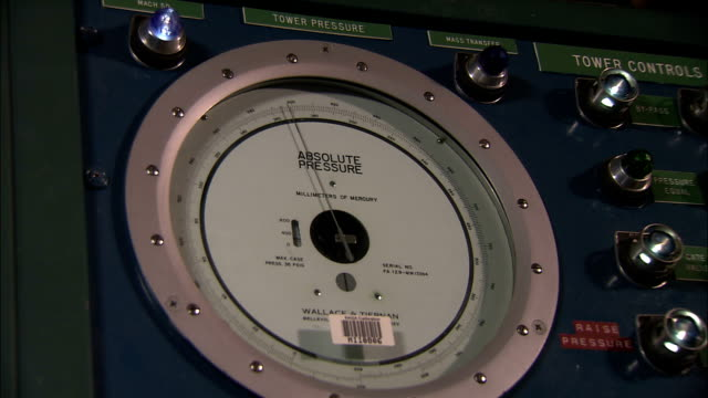 A pressure gauge operates on a control panel at the NASA Ames Research Center.