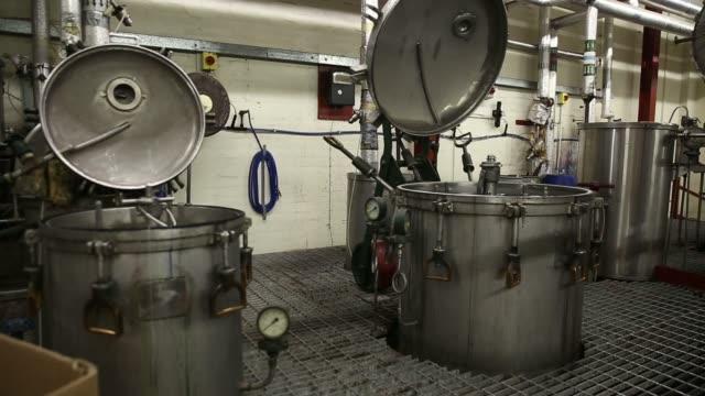 vídeos y material grabado en eventos de stock de pressure guages sit by machinery at lochcarron john buchan ltds textile plant in selkirk, uk, on tuesday, aug 12 large vats sit in production area,... - tartán