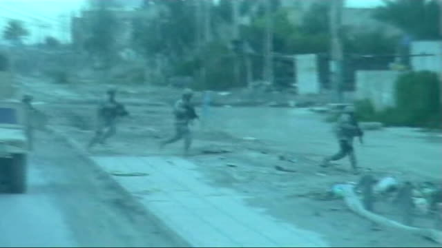 pressure on us military strategy in baghdad; tx march 2003 baghdad: us soldiers on duty as gunfire heard sot - baghdad stock videos & royalty-free footage