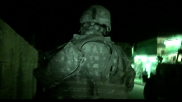 Pressure on US military strategy in Baghdad TX March 2007 Baghdad EXT / NIGHT US soldiers on night patrol through Baghdad city streets end US...