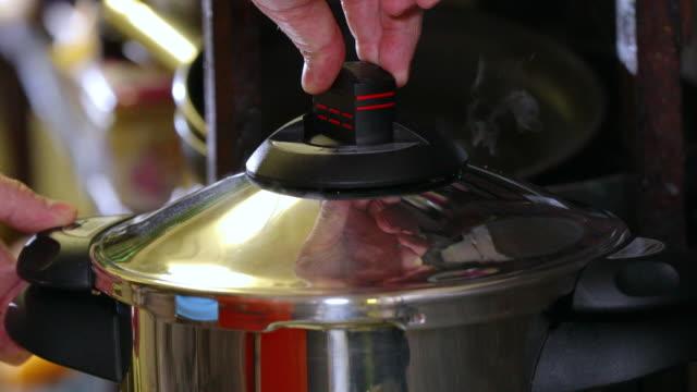 pressure reduction of a pressure cooker. - annick vanderschelden stock videos & royalty-free footage