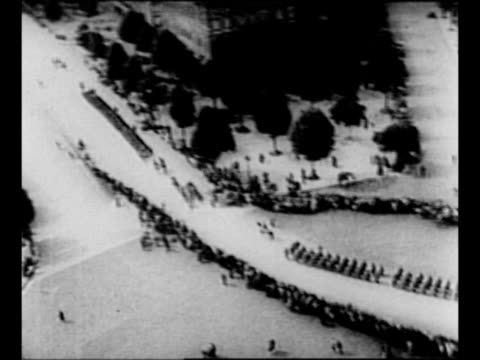 pov presumably from top of arc de triomphe of german soldiers marching down champs elysees after taking paris during world war ii / montage adolf... - arch architectural feature stock videos and b-roll footage