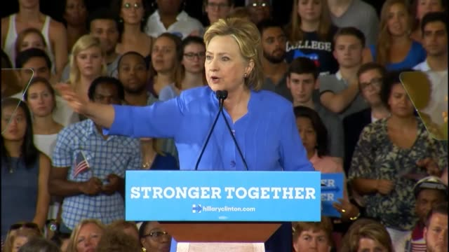Presumptive Democratic presidential candidate Hillary Clinton tells a Cincinnati audience that she would work to reward companies who share profits...