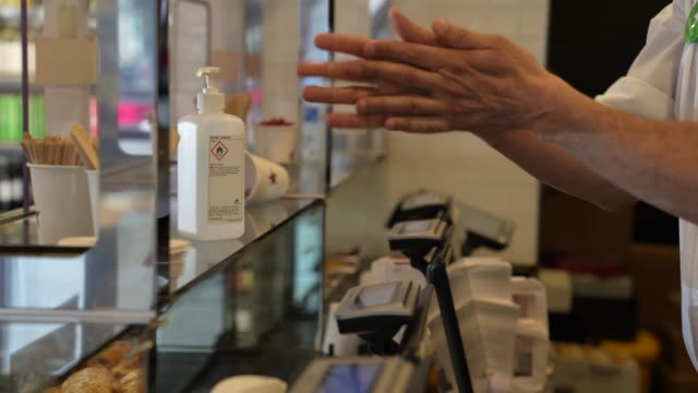pret member of staff washes their hands as pret a manger shop reopens in central london due to the coronavirus pandemic - economy stock videos & royalty-free footage