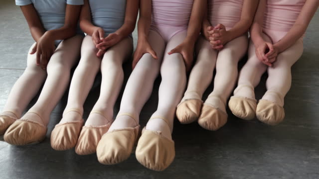 preteen ballerinas sitting side by side on floor and smiling - sitting on floor stock videos and b-roll footage