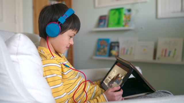 preteen boy using tablet computer to attend online class - digital native stock videos & royalty-free footage