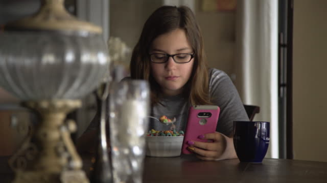 pre-teen girl on mobile phone - breakfast cereal stock videos & royalty-free footage