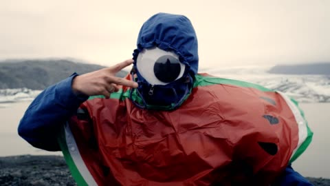 pretending to be a cyclops. man having fun at glacier lagoon - spectacles stock videos & royalty-free footage