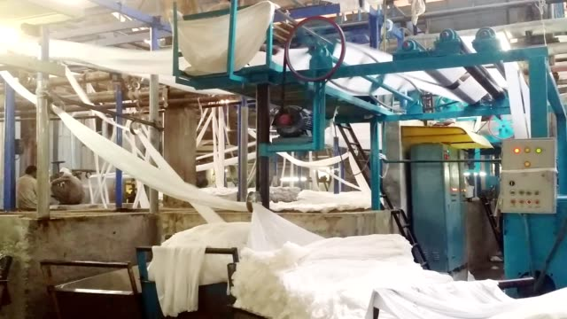 pretreatment of fabrics on textile machinery. - textile stock videos & royalty-free footage
