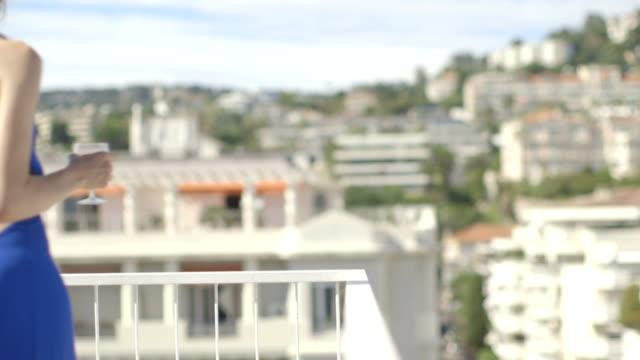 stockvideo's en b-roll-footage met pretty adult female in summer on terrace - balkon