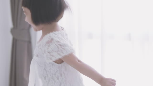 pretty asian playing in white room - childhood stock videos & royalty-free footage
