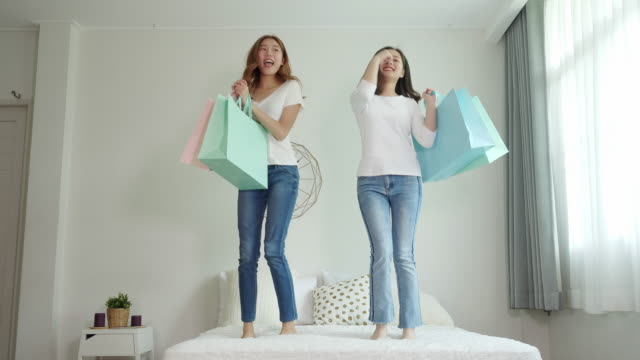 pretty asian women holding shopping bag - bag stock videos & royalty-free footage