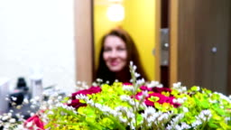 Pretty beautiful woman receive / get a bouquet of flowers, surprise, present, smiling