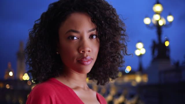 pretty black female with determined look staring at camera by pont alexandre iii - pont alexandre iii stock videos & royalty-free footage