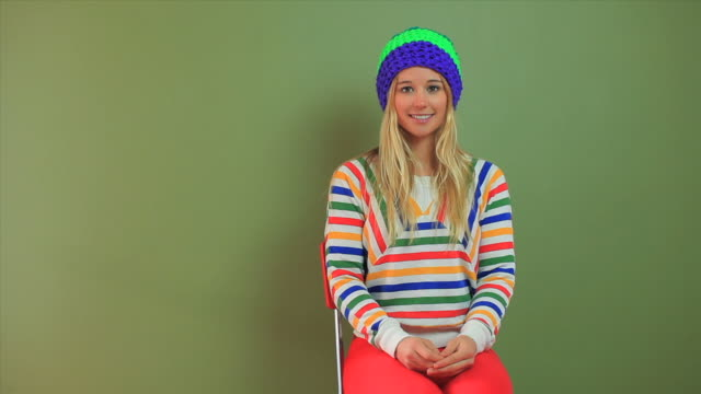 a pretty blond woman poses with a variety of winter hats and sweaters. - jumper stock videos & royalty-free footage
