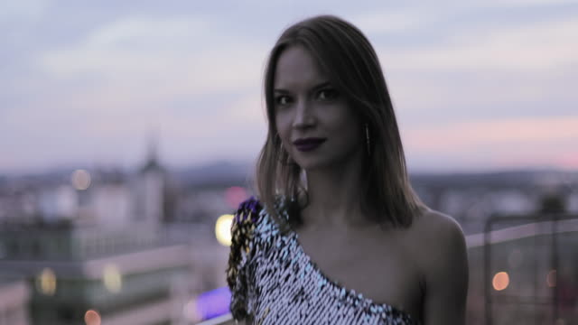 pretty caucasian woman in cocktail dress on rooftop looking at view - cocktail dress stock videos & royalty-free footage