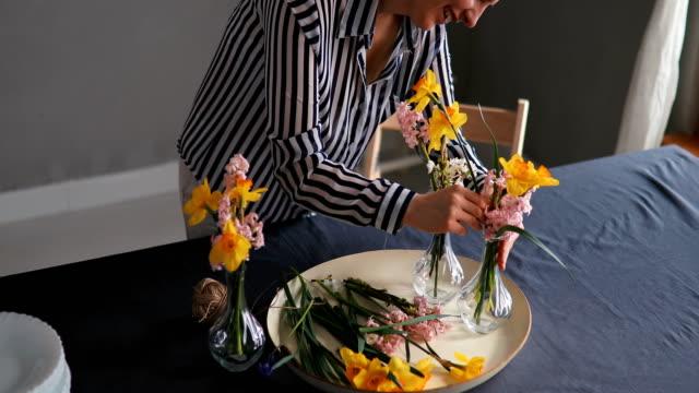 Pretty Caucasian woman making flower decoration.