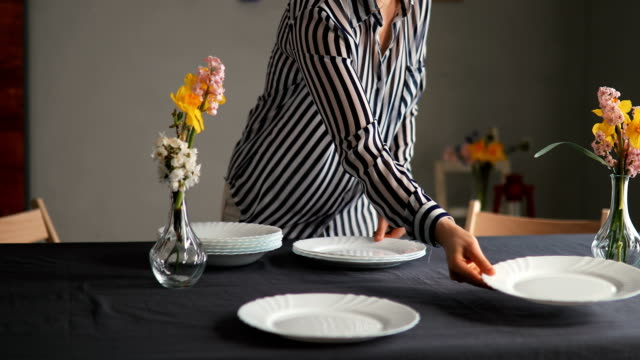 pretty caucasian woman setting up table for lunch - grace stock videos & royalty-free footage