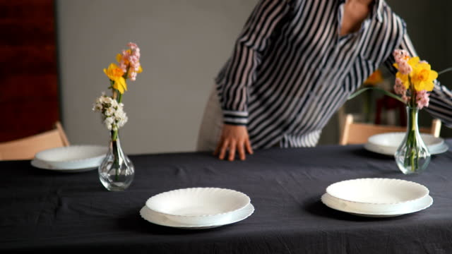 pretty caucasian woman setting up table for lunch - setting the table stock videos & royalty-free footage