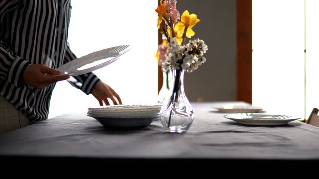 pretty caucasian woman setting up table for lunch - plain stock videos & royalty-free footage