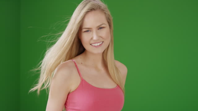 pretty caucasian woman smiling on green screen - blowing stock videos & royalty-free footage