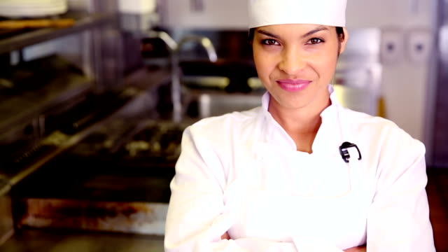 pretty chef smiling at camera - chef's hat stock videos & royalty-free footage