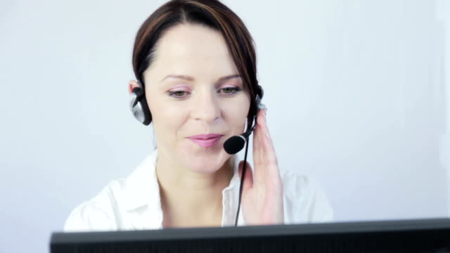 pretty customer service at work. - headset stock videos & royalty-free footage